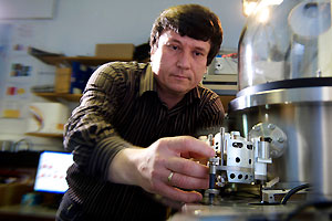 A physicist working on a piece of equipment