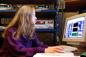 A physics student at a computer